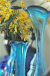 Yellow flowers in blue glass vase Stock Photo - Premium Royalty-Freenull, Code: 689-05612112