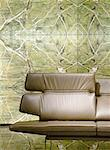 Brown leather couch in front of green wallpaper Stock Photo - Premium Royalty-Free, Artist: CulturaRM, Code: 689-05612181