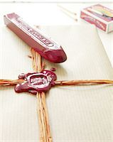 stamped - Gift is being sealed Stock Photo - Premium Royalty-Freenull, Code: 689-05612378