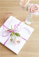 Wrapped gift with rose blossoms Stock Photo - Premium Royalty-Freenull, Code: 689-05612379