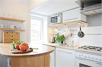 stove - Kitchen with tomatoes on counter Stock Photo - Premium Royalty-Freenull, Code: 689-05612388