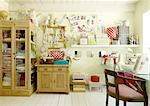 Room with cabinet, cuddly toys, storage boxes and chair at desk Stock Photo - Premium Royalty-Free, Artist: Blend Images, Code: 689-05612465