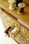 Dresser with bobbin thread and many drawers Stock Photo - Premium Royalty-Freenull, Code: 689-05612467