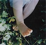 Feet of Baby in Clover Stock Photo - Premium Royalty-Free, Artist: Ty Milford, Code: 6106-05620588