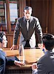Two Business men talking to executive at conference room table Stock Photo - Premium Royalty-Free, Artist: Ikon Images, Code: 6106-05621079