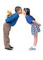 preteen kissing - Boy Kissing Girl Stock Photo - Premium Royalty-Freenull, Code: 6106-05621391