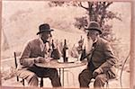 Two Men Talking over Wine Stock Photo - Premium Royalty-Free, Artist: Dan Lim, Code: 6106-05621944