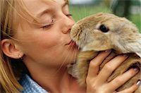 preteen kissing - Girl Kissing a Rabbit Stock Photo - Premium Royalty-Freenull, Code: 6106-05623677