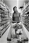 Woman Grocery Shopping at a Supermarket Stock Photo - Premium Royalty-Free, Artist: Steve Craft, Code: 6106-05623858