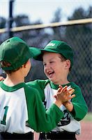 Two Boys High Fiving Stock Photo - Premium Royalty-Freenull, Code: 6106-05624016