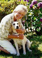 Mature Woman With a Dog Stock Photo - Premium Royalty-Freenull, Code: 6106-05624199