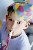 Boy at a Birthday Party Stock Photo - Premium Royalty-Freenull, Code: 6106-05625092