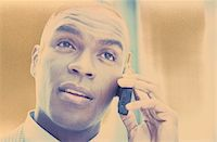 Businessman Talking on a Cellular Phone Stock Photo - Premium Royalty-Freenull, Code: 6106-05625290