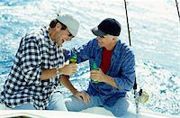 Father & Son Drinking Beer and Fishing Stock Photo - Premium Royalty-Freenull, Code: 6106-05625360