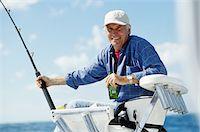 Man Fishing Stock Photo - Premium Royalty-Freenull, Code: 6106-05625364