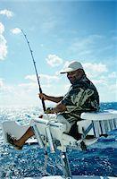 Man Fishing Stock Photo - Premium Royalty-Freenull, Code: 6106-05625365