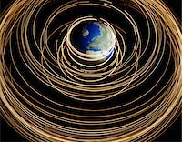 Lights orbiting planet Earth Stock Photo - Premium Royalty-Freenull, Code: 6106-05626878