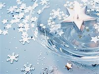 Floating candle, stars and snowflake confetti Stock Photo - Premium Royalty-Freenull, Code: 6106-05629753