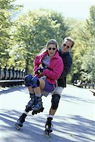 roller skate - Couple in-line skating, man lifting woman up Stock Photo - Premium Royalty-Freenull, Code: 6106-05632596