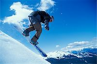 sports and snowboarding - Snowboarder descending slope Stock Photo - Premium Royalty-Freenull, Code: 6106-05632762