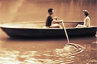 side view of person rowing in boat - Couple in rowing boat (focus on woman) Stock Photo - Premium Royalty-Freenull, Code: 6106-05636590