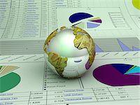 Globe and Pie Chart Stock Photo - Premium Royalty-Freenull, Code: 6106-05638273