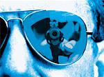 Man Aiming a Pistol Reflected in Another Man's Sunglasses Stock Photo - Premium Royalty-Free, Artist: Glowimages               , Code: 6106-05639547
