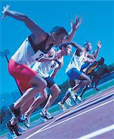 sprint - Track Athletes Starting a Race Stock Photo - Premium Royalty-Freenull, Code: 6106-05640048
