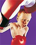Portrait of a Boy Wearing Boxing Gloves Stock Photo - Premium Royalty-Free, Artist: Glowimages               , Code: 6106-05640121