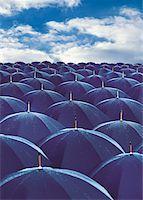 Umbrellas Under Clouds Stock Photo - Premium Royalty-Freenull, Code: 6106-05640153
