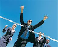 sprint - Business People Crossing Finish Line Stock Photo - Premium Royalty-Freenull, Code: 6106-05640209