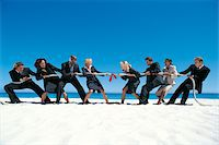 Business People Playing Tug-of-War on the Beach Stock Photo - Premium Royalty-Freenull, Code: 6106-05640218