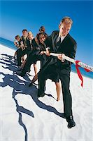 Business People Playing Tug-of-War Stock Photo - Premium Royalty-Freenull, Code: 6106-05640219