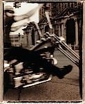 Man riding motorcycle in urban street (blurred motion, toned B&W) Stock Photo - Premium Royalty-Free, Artist: George Shelley, Code: 6106-05641182