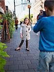 Boy Taking Photograph of Girl, Front Street, Toronto, Ontario, Canada