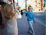 Girl Taking Photograph of Boy, Front Street, Toronto, Ontario, Canada