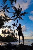 Fisherman Standing on Beach, Ahangama, Sri Lanka Stock Photo - Premium Rights-Managednull, Code: 700-05642147