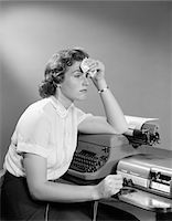 secretary desk - 1950s AILING WOMAN SECRETARY SITTING AT DESK WITH TYPEWRITER AND DICTATION MACHINE HOLDING HANDKERCHIEF TO FOREHEAD Stock Photo - Premium Rights-Managednull, Code: 846-05645857