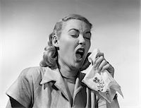 people coughing or sneezing - 1950s WOMAN SNEEZING COUGHING INTO HANDKERCHIEF Stock Photo - Premium Rights-Managednull, Code: 846-05645866