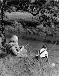 1930s BOY & GRANDFATHER FISHING ON BANK OF STREAM