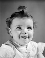 1940s BABY GIRL SMILING STICKING OUT HER TONGUE Stock Photo - Premium Rights-Managednull, Code: 846-05645982