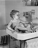 1940s GIRL SITTING IN SINK LATHERED WITH SOAP Stock Photo - Premium Rights-Managednull, Code: 846-05645997