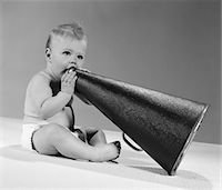 1960s BABY IN DIAPER SEATED HOLDING MEGAPHONE Stock Photo - Premium Rights-Managednull, Code: 846-05646036