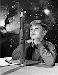 1960s BOY WITH MODEL ROCKET AND OUTER SPACE BACKGROUND