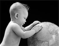 1940s BABY WITH HANDS ON GLOBE LOOKING AT THE EARTH Stock Photo - Premium Rights-Managednull, Code: 846-05646118