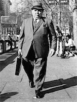 fat man full body - 1960s OVERWEIGHT BUSINESSMAN WITH BRIEFCASE SMOKING CIGAR WALKING ON CITY SIDEWALK Stock Photo - Premium Rights-Managednull, Code: 846-05646172