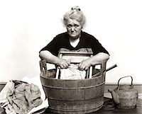 1920s - 1930s - 1940s SENIOR WOMAN WASHING CLOTHES IN OLD FASHIONED WOODEN TUB AND WASHBOARD Stock Photo - Premium Rights-Managednull, Code: 846-05646188