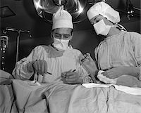 1950s DOCTOR AND NURSE STANDING OVER PATIENT ABOUT TO OPERATE Stock Photo - Premium Rights-Managednull, Code: 846-05646308