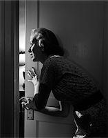 1950s WOMAN PEEKING THROUGH OPEN DOOR Stock Photo - Premium Rights-Managednull, Code: 846-05646375