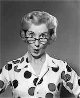 superior - 1950s - 1960s PORTRAIT WOMAN POLKA DOT DRESS LOOKING OVER EYEGLASSES Stock Photo - Premium Rights-Managednull, Code: 846-05646403